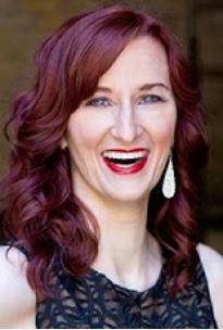 Smiling woman with red hair