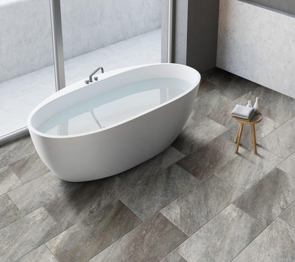 bath scene with tile floor that looks like quartzite