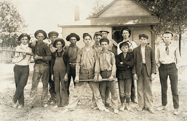 Old photo of young men ready for baseball...or hunting.