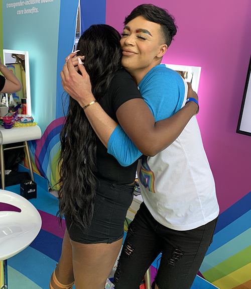 Jose and Claudia Hugging at the TurnUpTheLove Salon