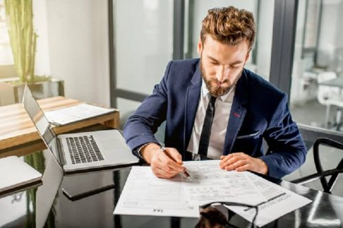 A finance professional reads documents.