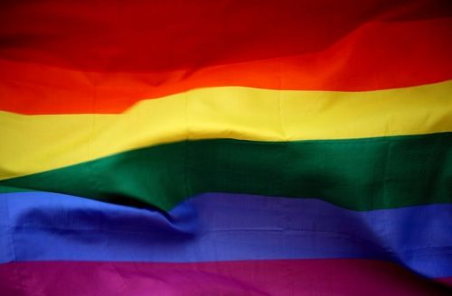 A close-up picture of the rainbow LGBTQ+ pride flag, with red, orange, yellow, green, blue, and purple stripes.