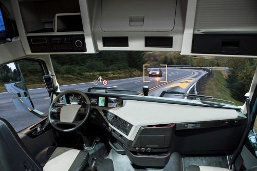 View from inside an autonomous vehicle driving down the road.