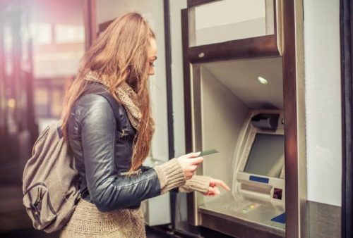A college student at an ATM.
