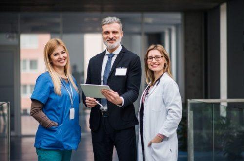A hospital CEO meets with a head nurse and a doctor.