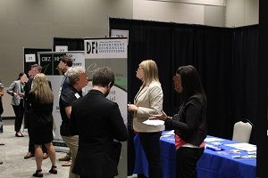 UND Accountancy Career Fair attendees speak with recruiters.