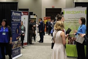 UND Accountancy Career Fair attendees network with recruiters.
