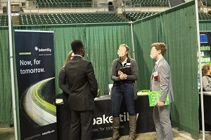 UND Spring Career Fair participants network with recruiters.