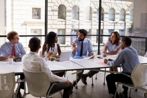 An internal auditor meets with his company's five-member audit committee to discuss internal controls.