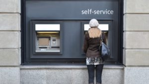 woman using a self-service automated teller machine