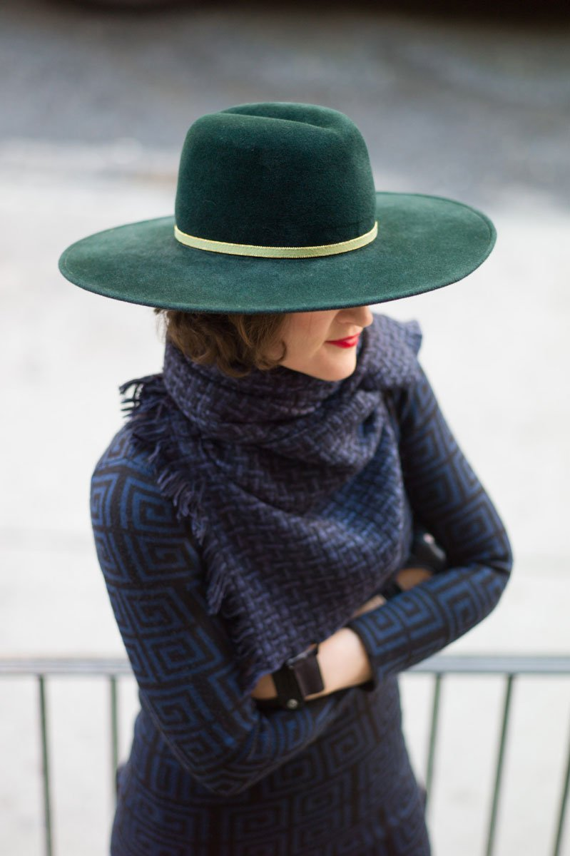 By Vlada hat designer wearing her flotus green felt hat and scarf