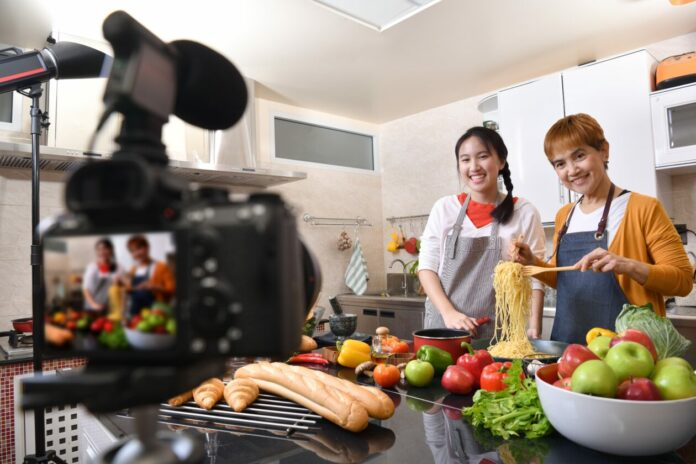 Mother and daughter blogger vlogger and online influencer recording video content on healthy food. YouTube channel creation guide.