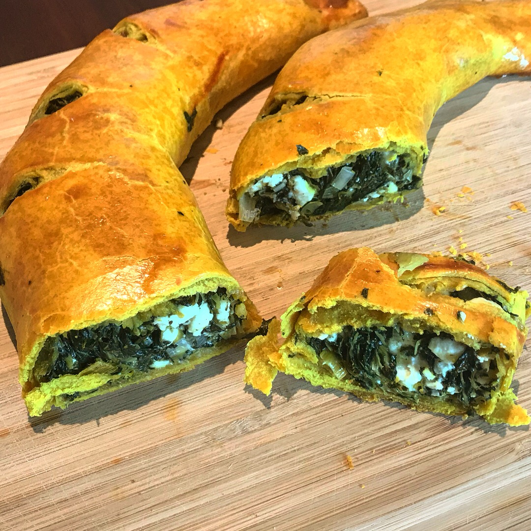 Veronica's Wisconspin Strudel features a golden turmeric crust and green spinach filling for an homage to the Packers.
