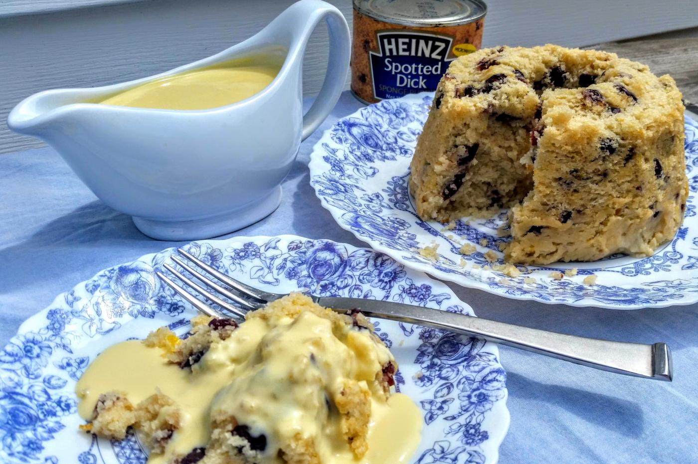 Stephanie displays her steamed Spotted Dick pudding on blue and white china.