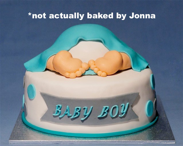 """""""Baby Boy"""" cake features a blanket-draped baby with toes peeking out."""