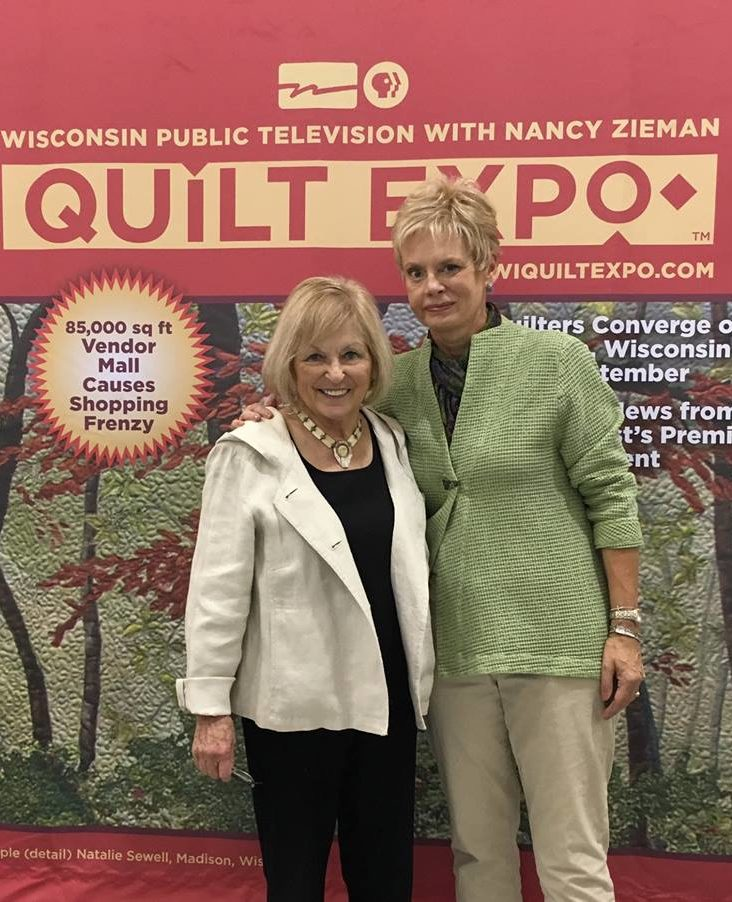 Natalie Sewell and Nancy Zieman pose together at Quilt Expo