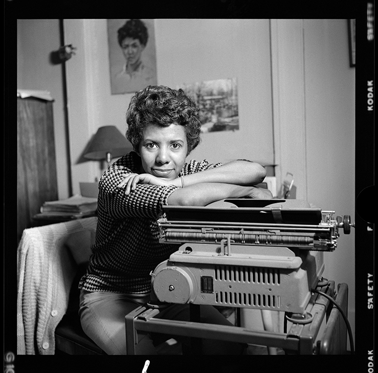 Lorraine Hansberry poses with her typewriter
