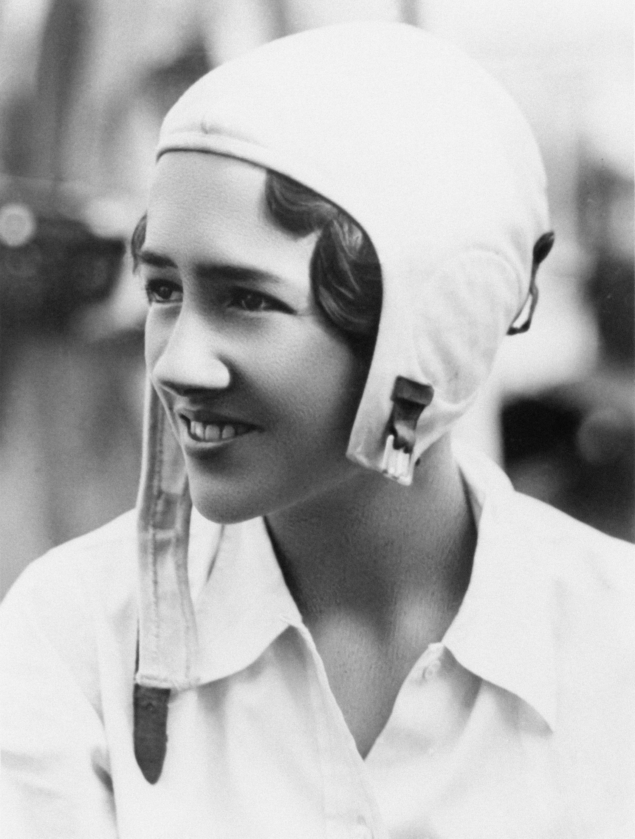 Anne Morrow Lindbergh poses in a leather aviators cap