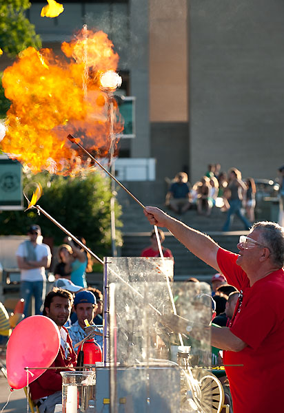 Chemistry professor Bassam Shakhashiri ignites a gas-filled balloon during a free demonstration about the science of fireworks held at the University of Wisconsin-Madison's Memorial Union Terrace on June 28, 2009. The outreach event, led by Shakhashiri and others from the Wisconsin Initiative for Science Literacy, explored the chemistry used to create the colors, shapes, light and explosive heat that combine to create fantastic firework displays such as the city's Rhythm and Booms that occurred later in the evening. W-Madison University Communications 608/262-0067 Photo by: Jeff Miller Date: 06/09 File#: NIKON D3 digital frame 2008