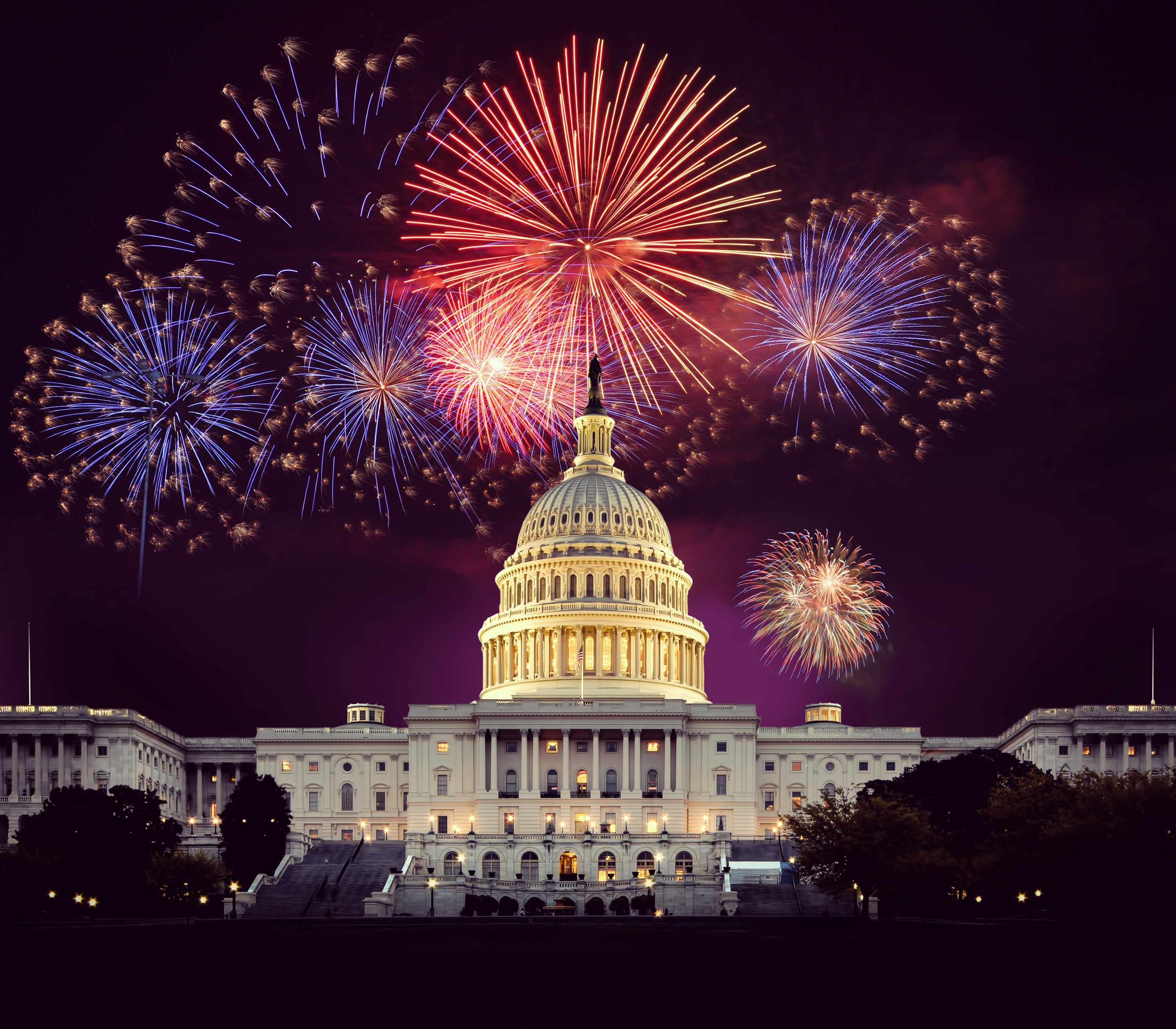 Fireworks explode above the U.S. Capitol