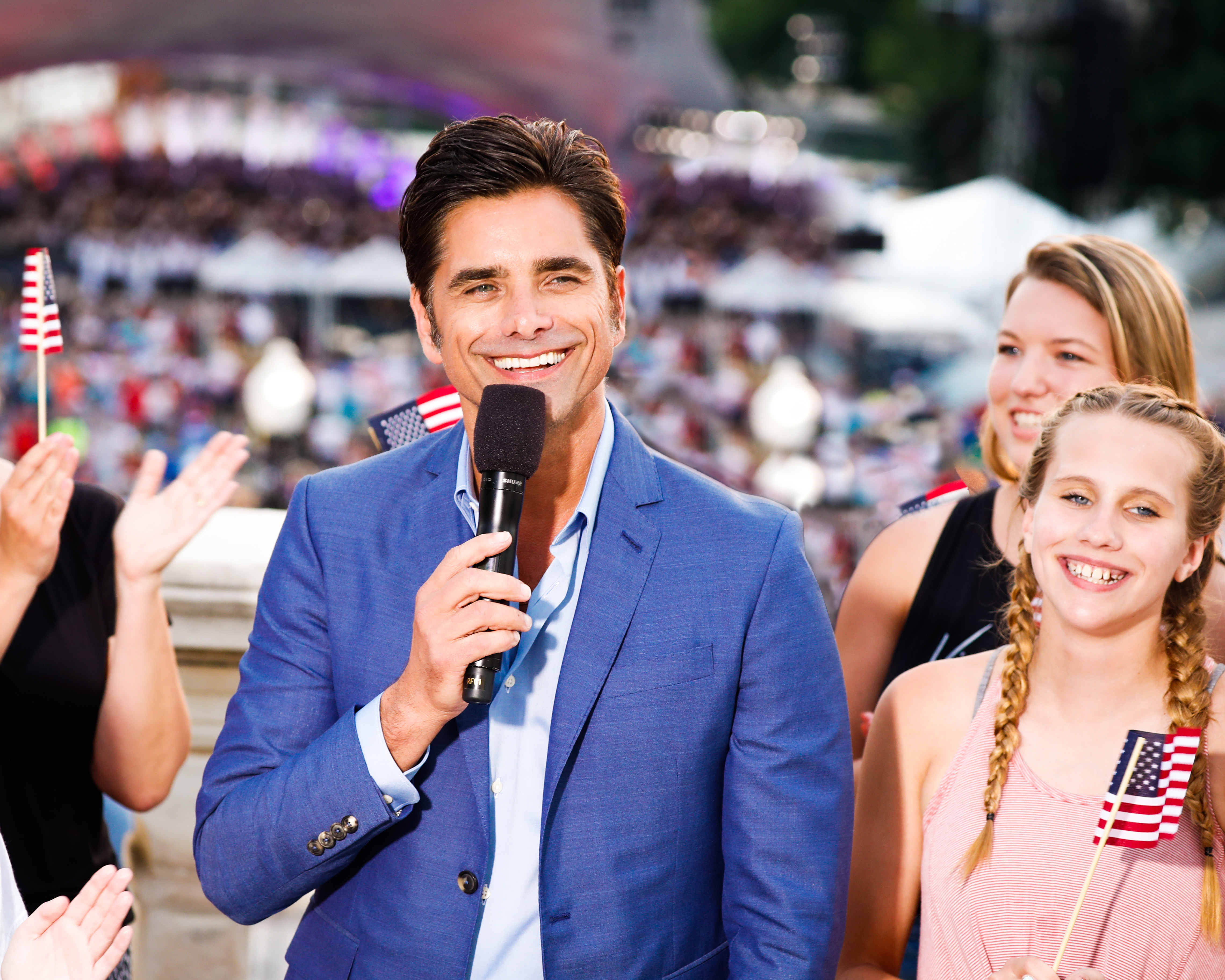 John Stamos poses with young performers