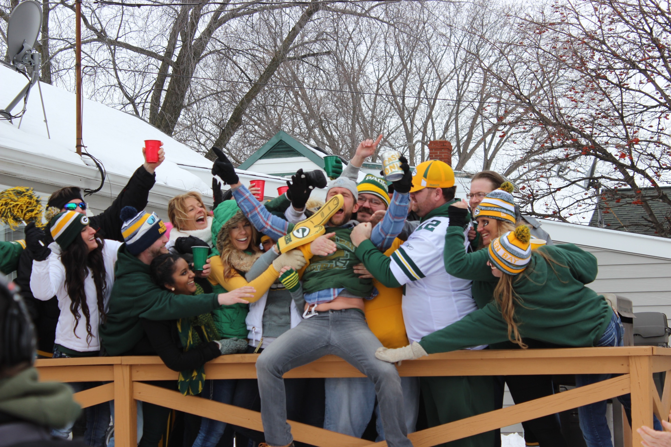 A crowd of Packers fans reenacts the Lambeau Leap in a scene from The 60-Yard Line.