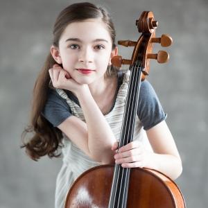 Cellist Miriam Smith leans on her cello
