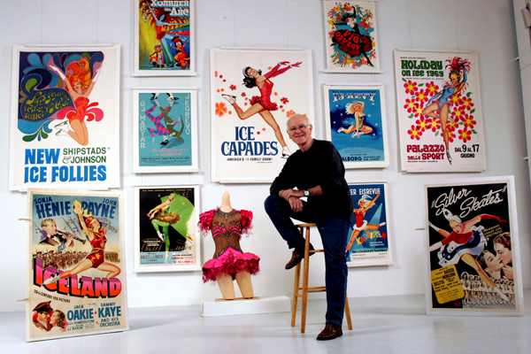 Roy Blakey poses in front of a few posters and other artifacts from his collection.