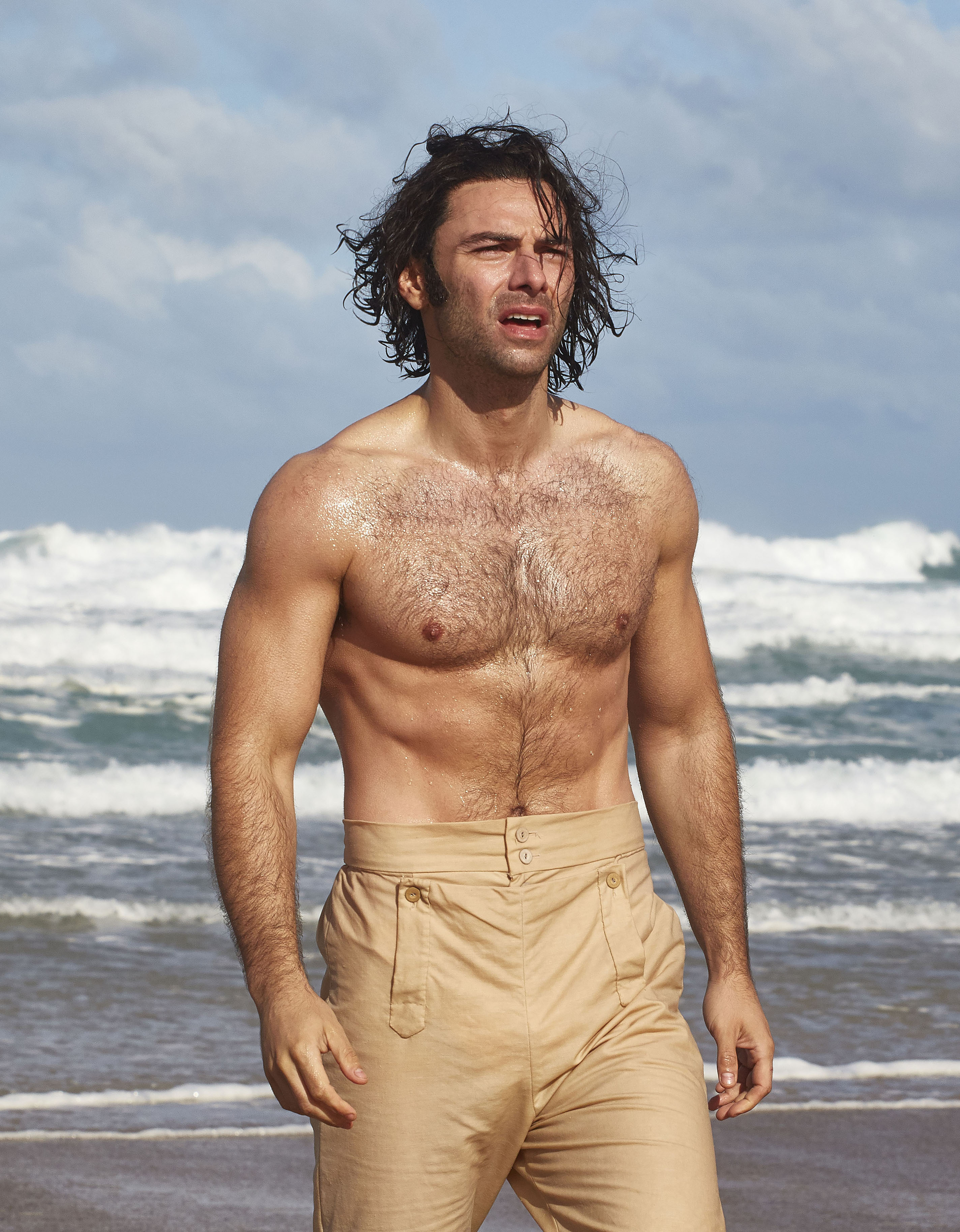 A shirtless Ross Poldark comes out of the ocean.