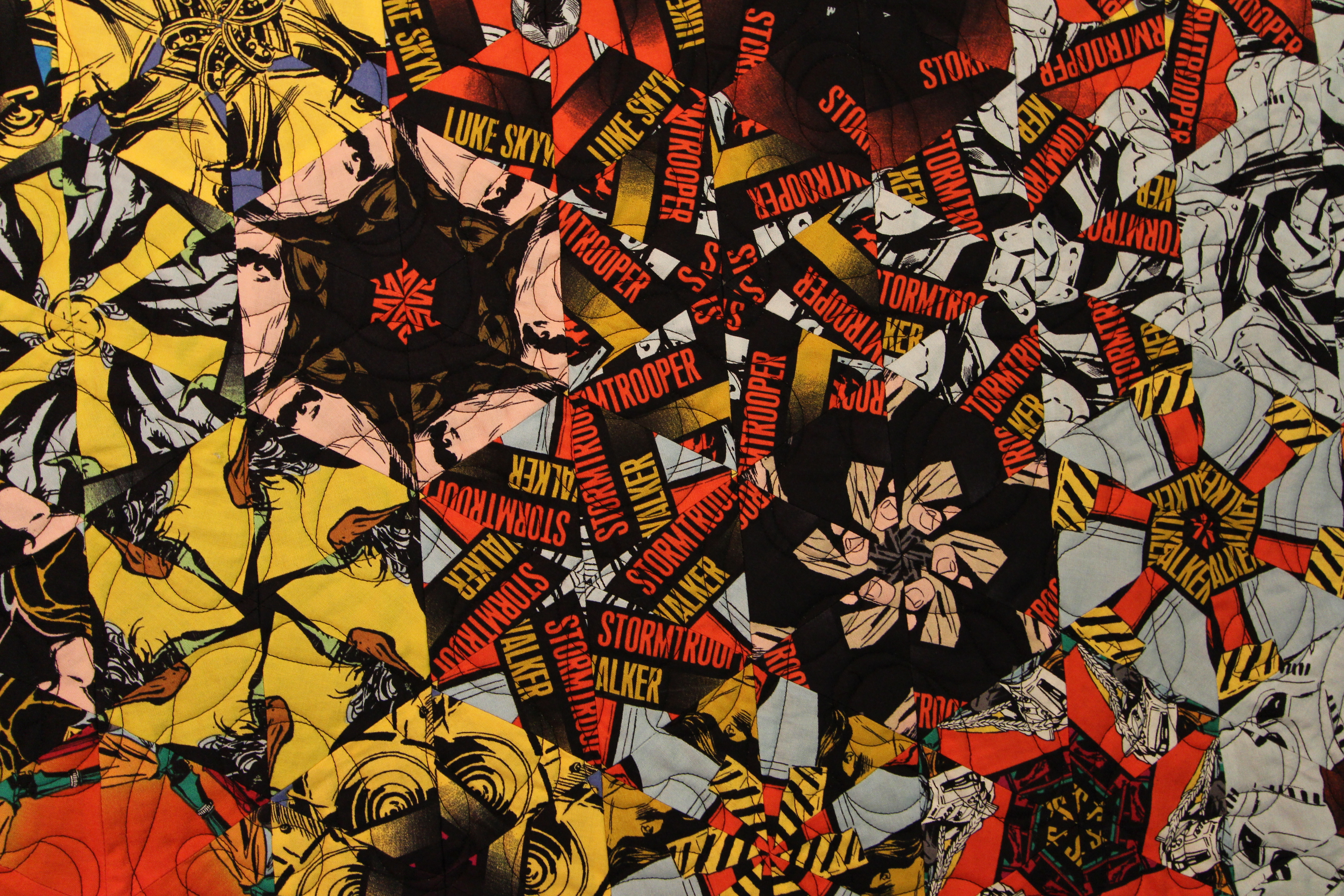 "Detail from Bruce Seeds' quilt ""The Force"" - note the action figure fabric used!"