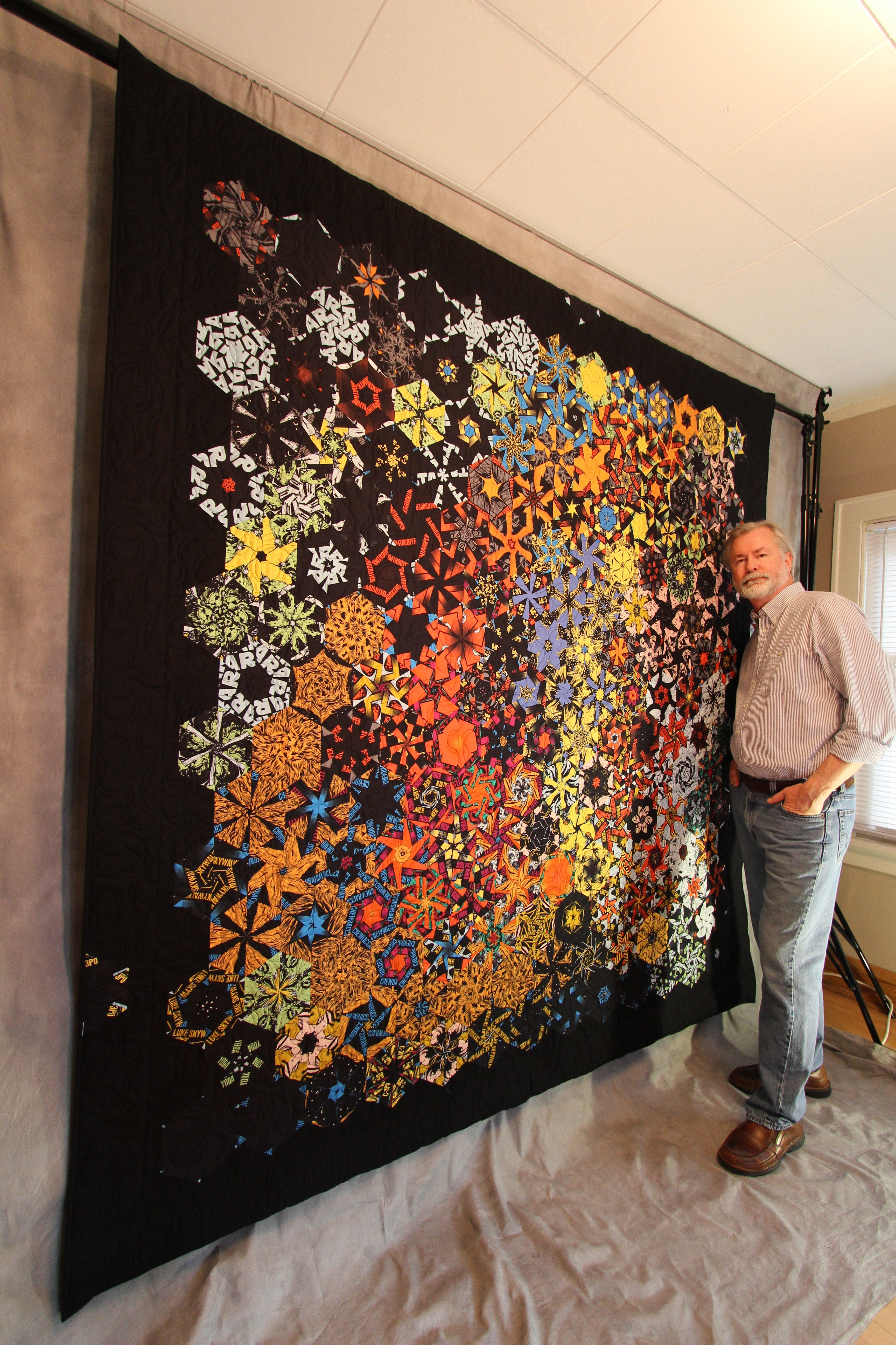 "Bruce Seeds, with his quilt ""The Force"""