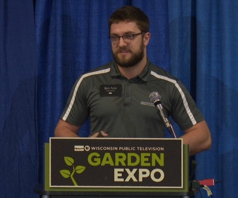 Allen Centennial Garden director Benjamin Futa speaks at a podium