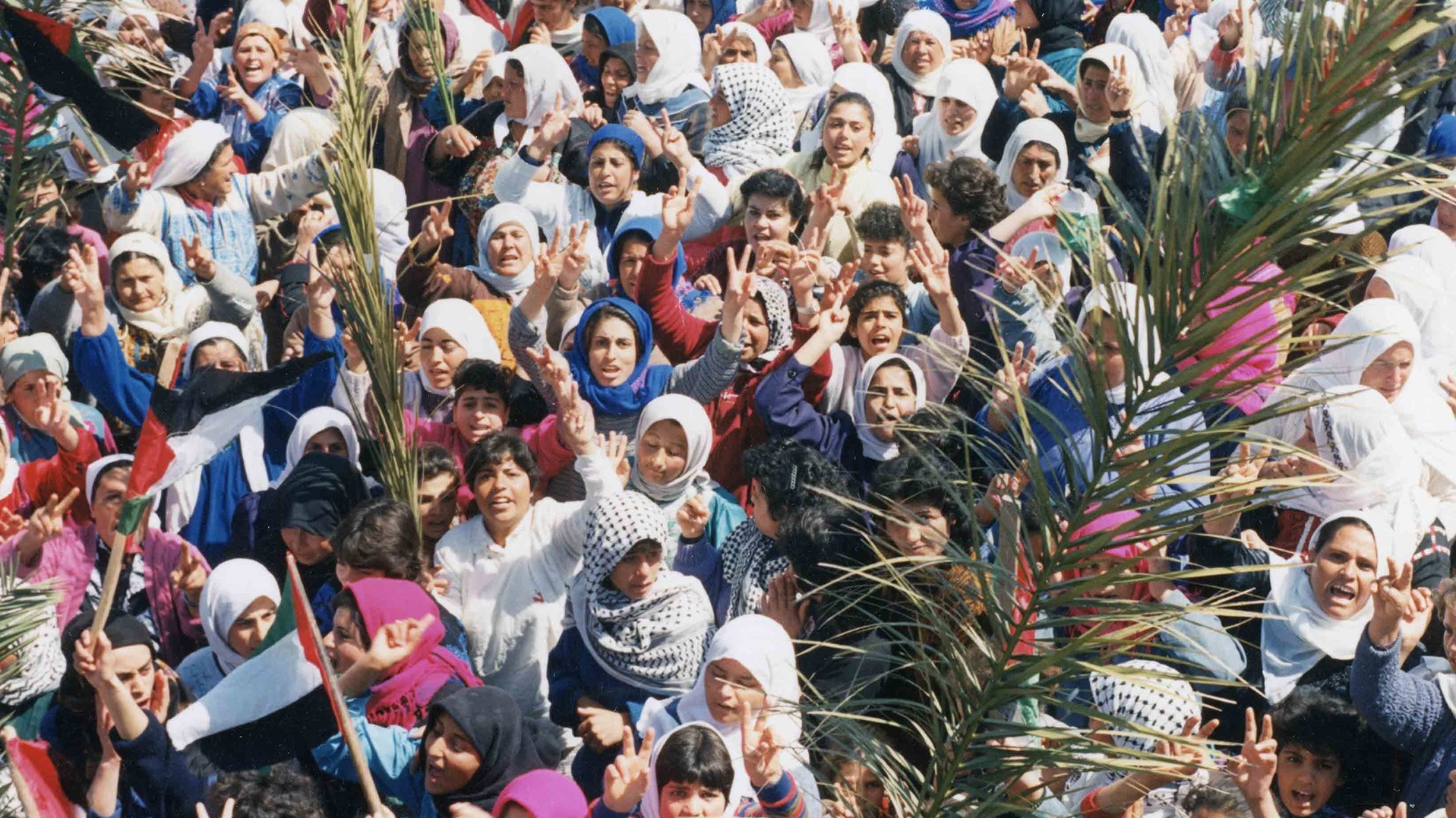 Women in headscarves protest in the Middle East in a photo from Women, War & Peace