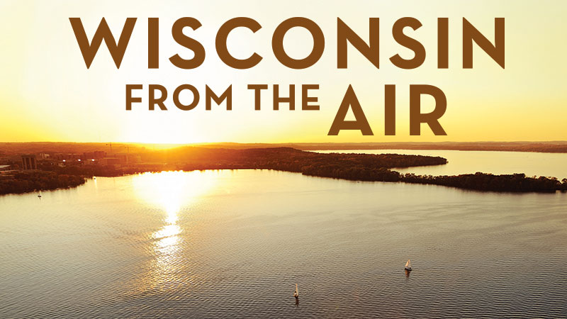 Image of Wisconsin From the Air Title with setting sun over a Lake Mendoa