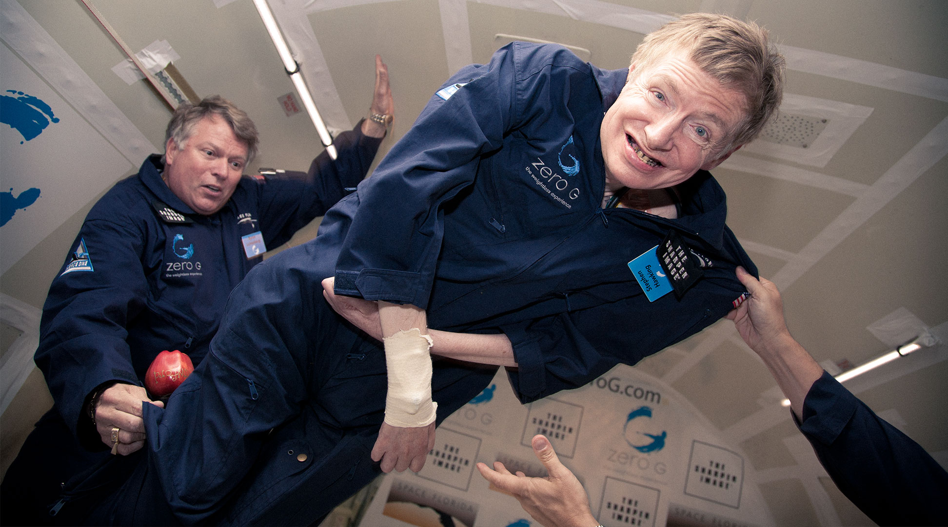 Stephen Hawking floats in a zero-gravity airplane environment. Photo by Steve Boxall