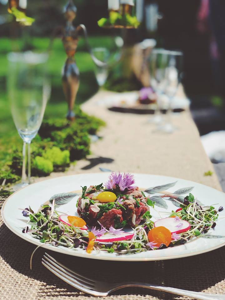 Bison tartare on an outdoor table