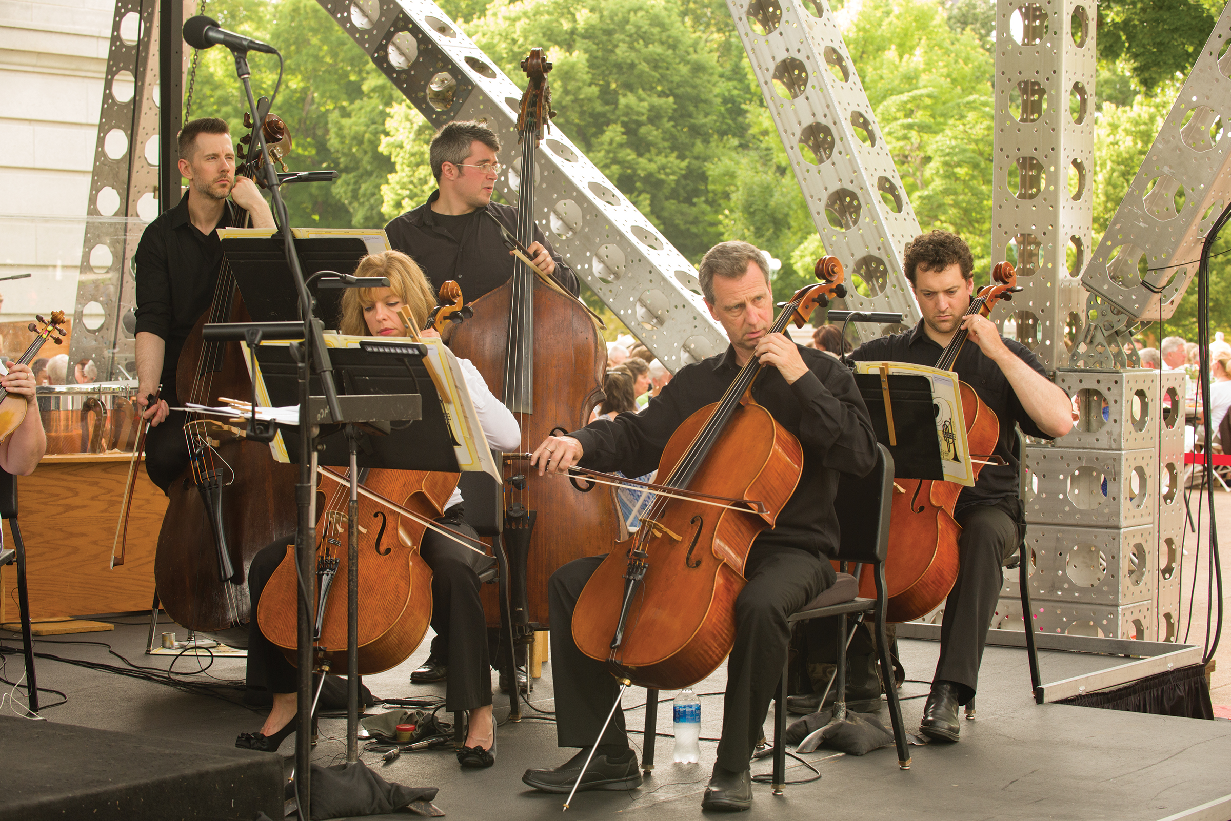 Cellists perform under the Concerts on the Square shell