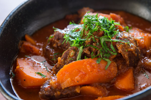 Beef stewed until fork tender with carrot chunks and carrot puree.
