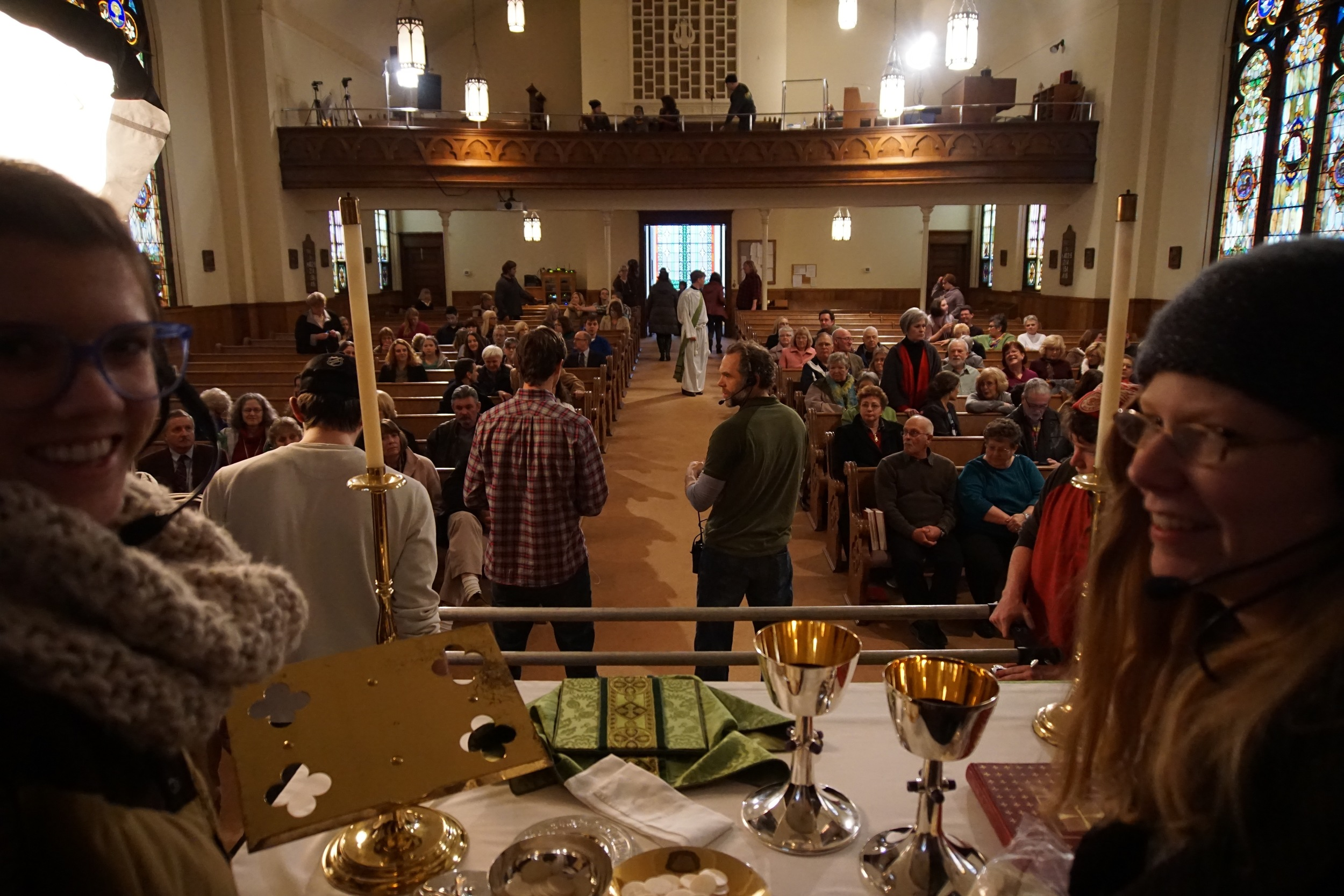From the altar, see church pews filled with Marinette residents filming a Mass scene in Aquarians.