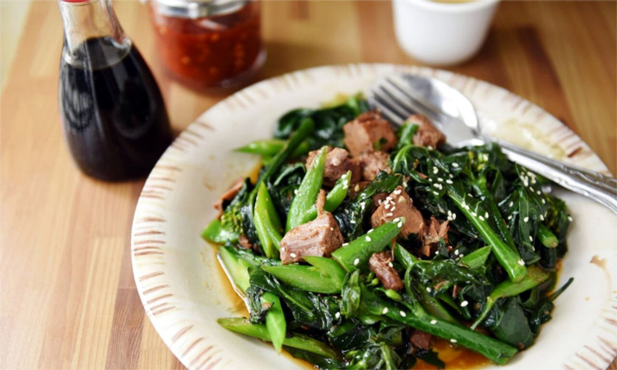 Green vegetables mix with chunks of meat in a dish from Yen Ching's menu.