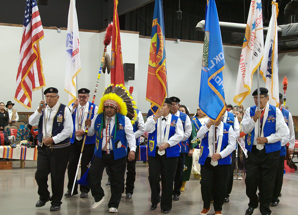 The honor guard enters with the U.S. flag and others at the Comanche Indian Veterans Association Celebration and Powwow