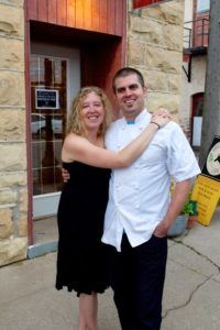 Ruthie Zahm and her beardless husband (in chef's whites) pose outside the cafe.