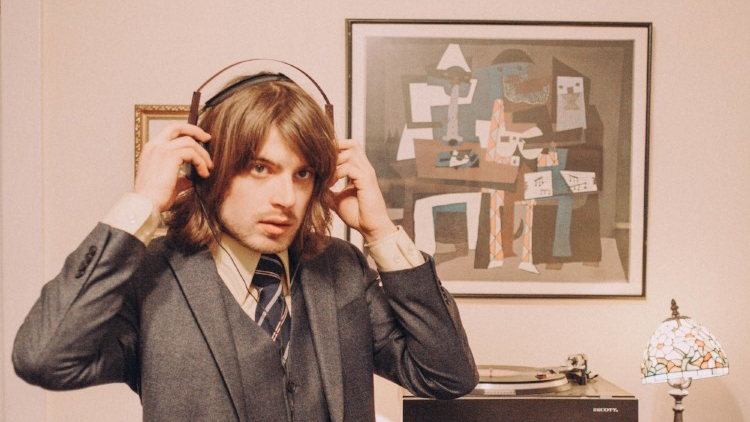 Photo of musician, Neal Francis, with headphones on.