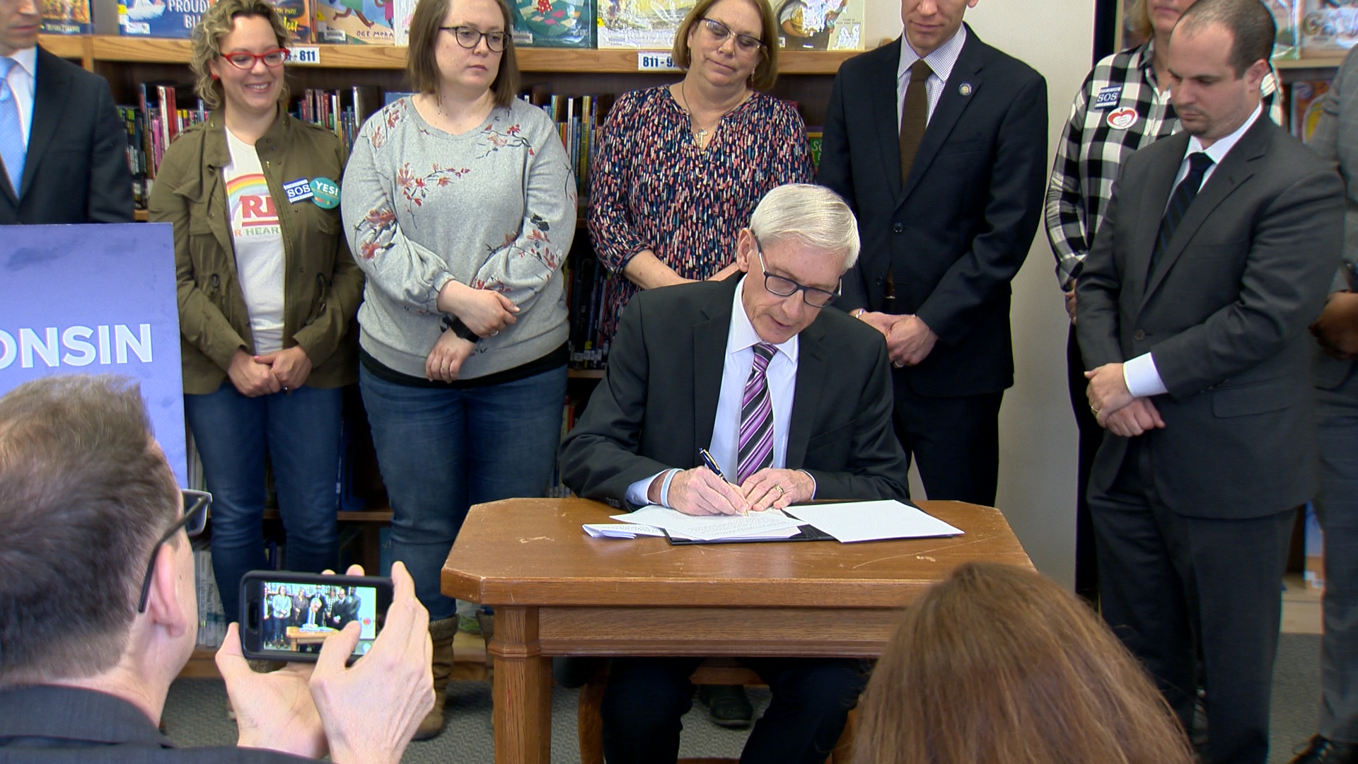 Gov. Tony Evers vetoes a Republican tax cut at Lincoln Elementary School in Wauwatosa Feb. 26, 2020.