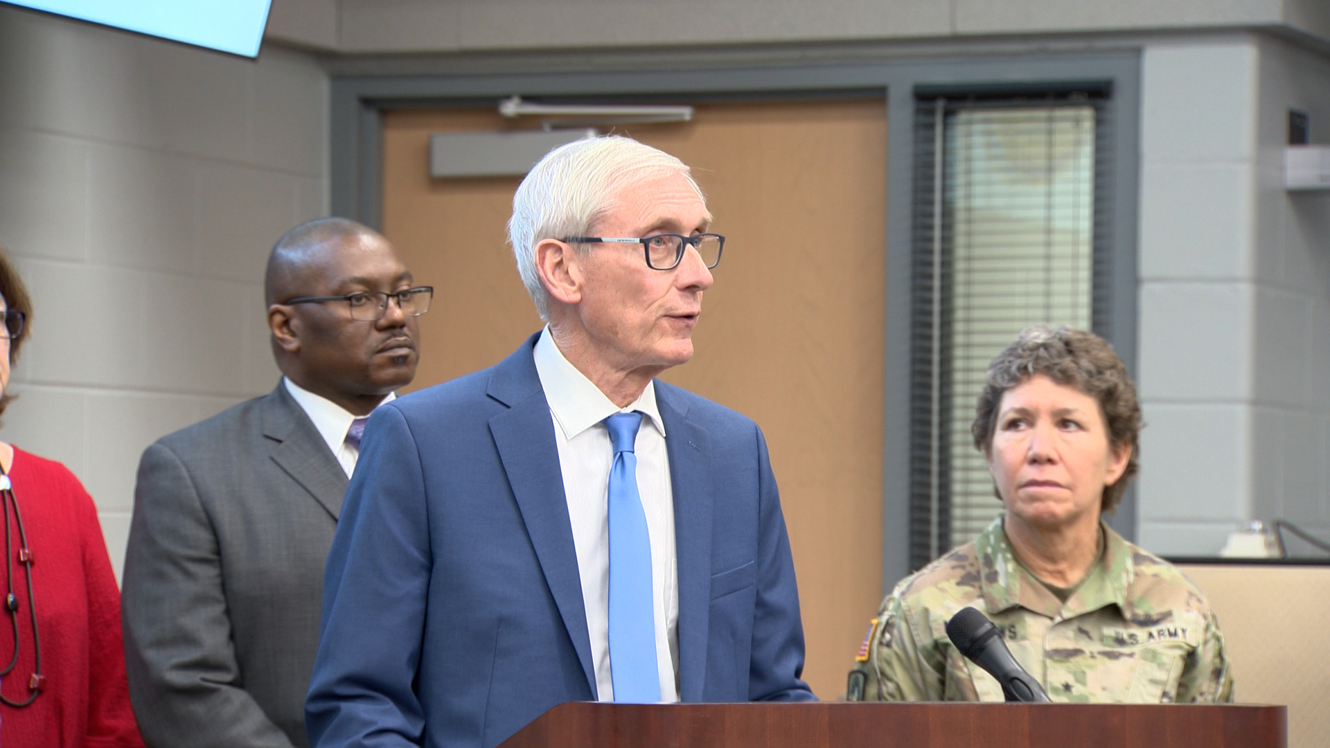 Tony Evers - Governor of Wisconsin stands at a podium at a press conference