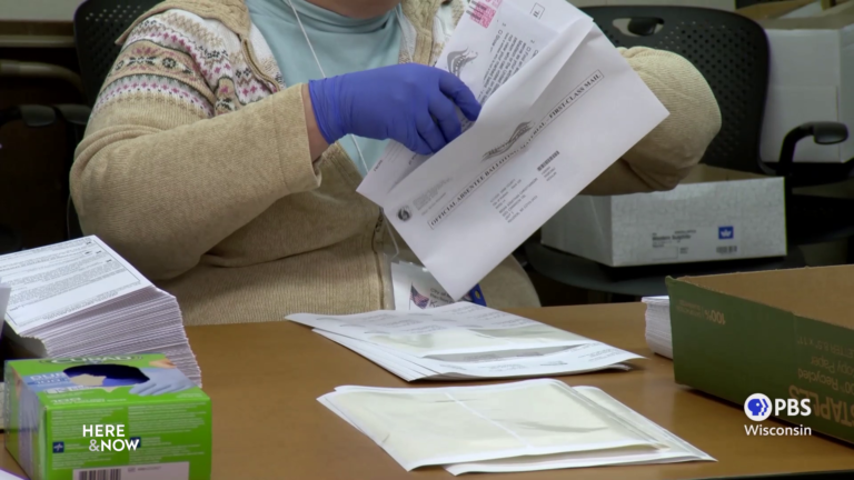 A city official prepares an absentee ballot in Madison.