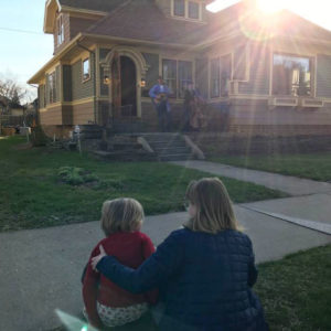 Neighbors watching a music performance