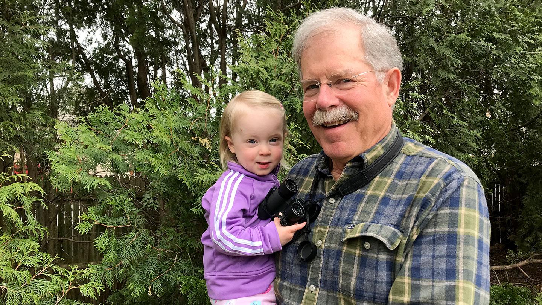 John Gurda holding his granddaughter