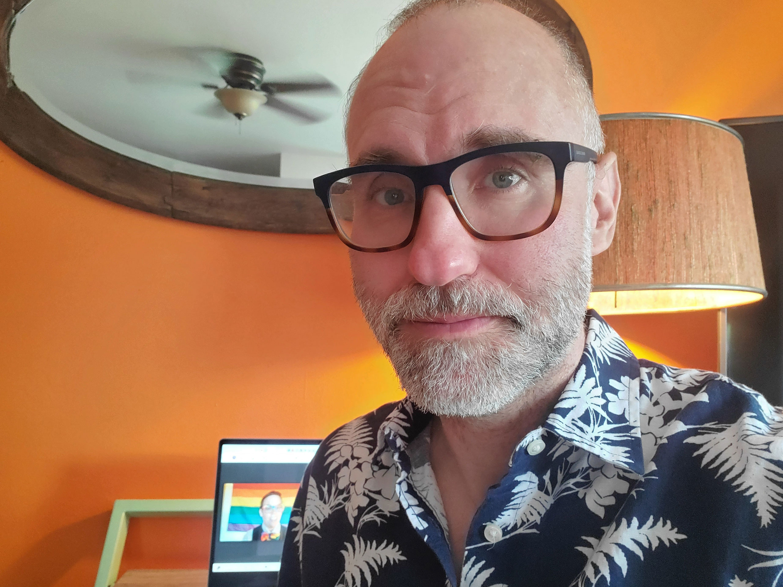 Man wearing palm print shirt and glasses