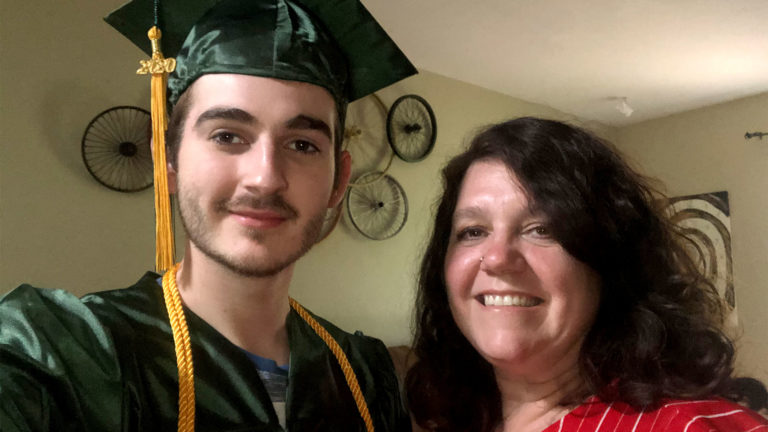 Image of Daniel Croake in Graduation Cap and Gown with mother Shelia Petitjean